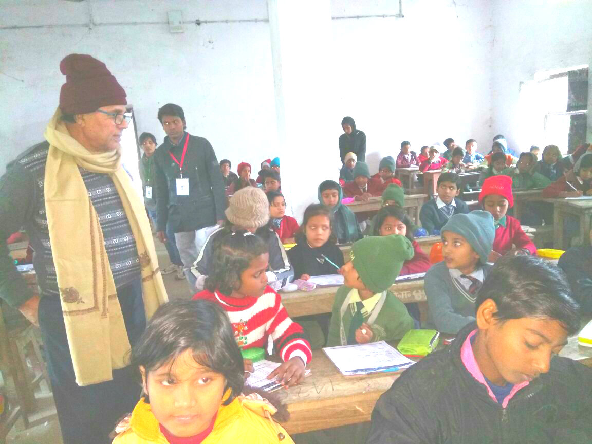 Patron Dr.Bhupendra Madhepuri talking to kids during the Spelling Bee Competition Exam at Madhepura.