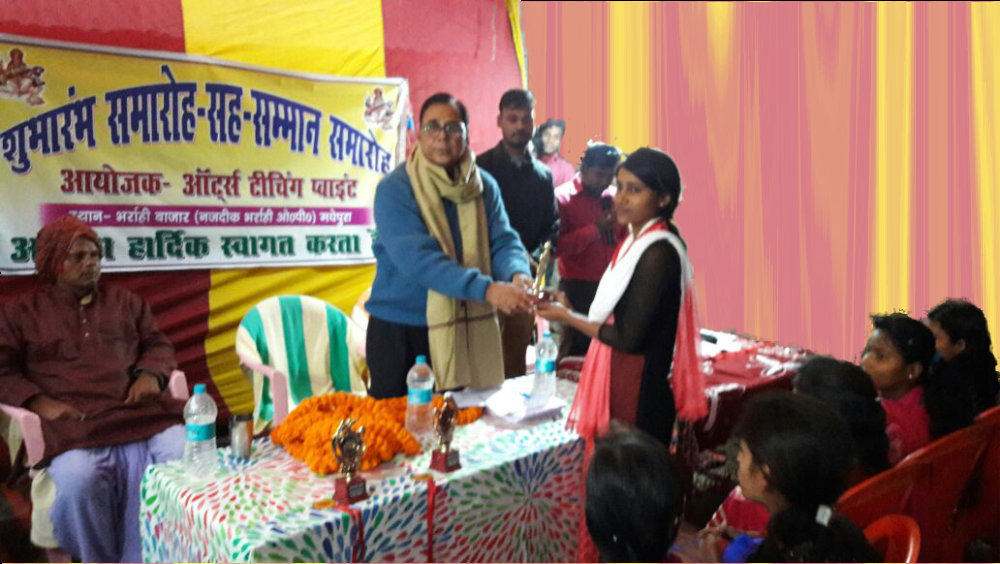 Educationist Dr.Bhupendra Madhepuri conferring medals & momentos to the village girl students scoring highest marks in their classes.
