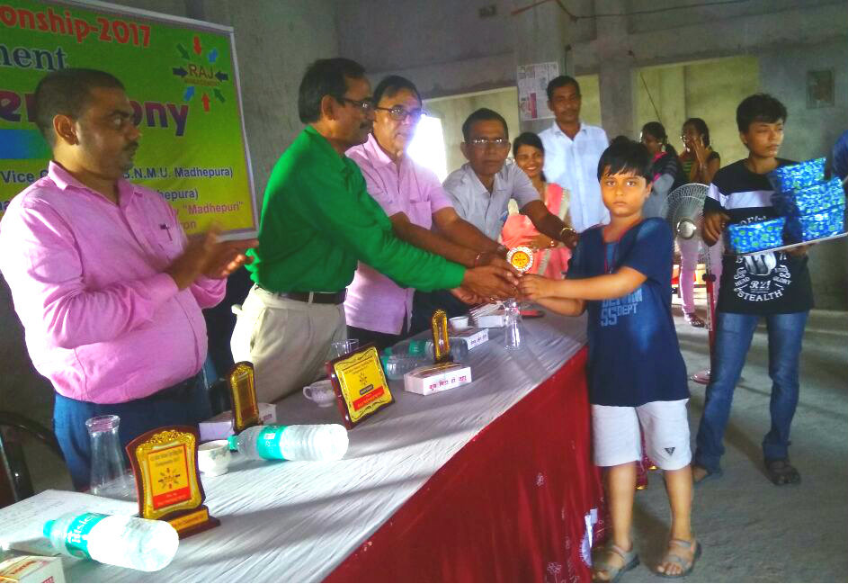 Aditya From Kidzee Madhepura receiving Spelling Bee Championship Prize from Pro. VC Dr.Farookh Ali , DSW Dr.Anil Kant Mishra.