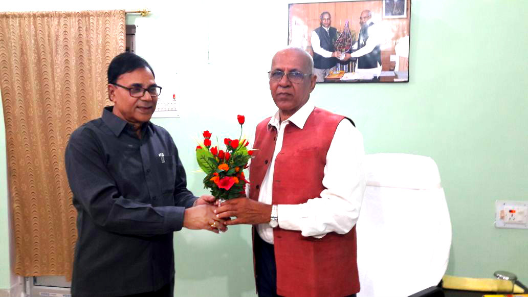 Educationist Dr.Bhupendra Madhepuri greeting Vice-Chancellor Dr.A.K.Rai for his outstanding works at B.N. Mandal University, Madhepura.