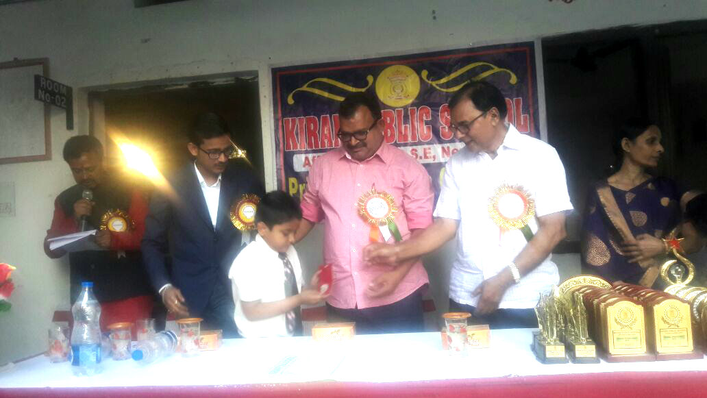 Educationist Dr.Bhupendra Madhepuri along with Sri Sanjay Kumar Nirala and Director MD Sri Aman Prakash giving a silver medal to a winning scholar kid of Kiran Public Madhepura.