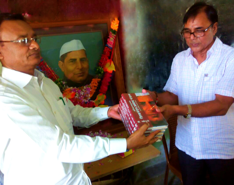 Educationist Dr.Bhupendra Madhepuri (An author of Itihas Purush Shiv Nandan Prasad Mandal) donating books to Md.Shakeel Ahmad, Principal of SNPM +2 for School Library.