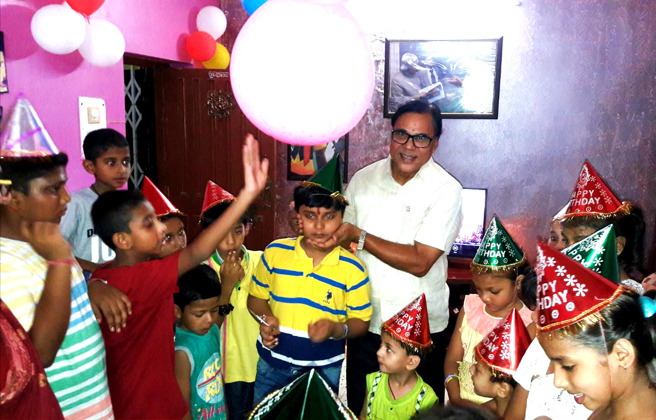 Dr.Madhepuri celebrating his grandson Aditya's birthday.