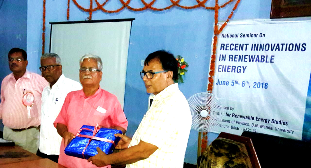 Former University Professor of Physics Dr.Bhupendra Narayan Madhepuri giving special gift to Former Director of IIT(Delhi) cum Chief Guest of Two Days National Seminar on Renewable Energy in presence of HOD Dr.Nikhil Prasad Jha & organising secretary Dr.Vimal Sagar organised by BNMU Madhepura.
