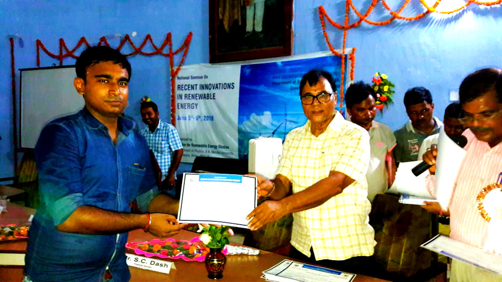 Dr.Madhepuri giving certificate to Research Scholar.