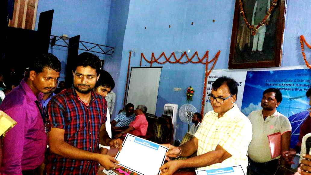 Research Scholar receiving certificate by Dr.Madhepuri on the eve of National Seminar on Renewable Energy organised by BNMU Madhepura.