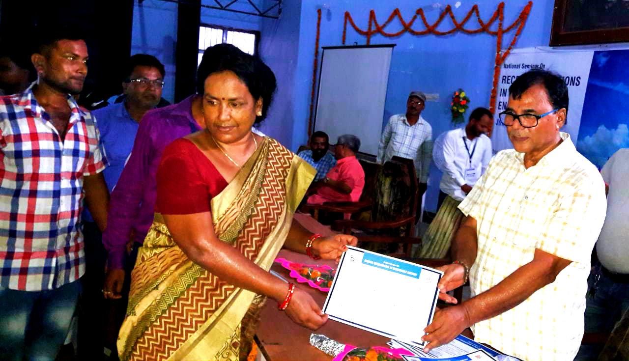 Educationist & Special Guest Prof(Dr.) B.N.Madhepuri giving certificate to Dr.Kumari Sadhana 'Suman' on the eve of attending National Seminar on Renewable Energy at BNMU Auditorium Madhepura.