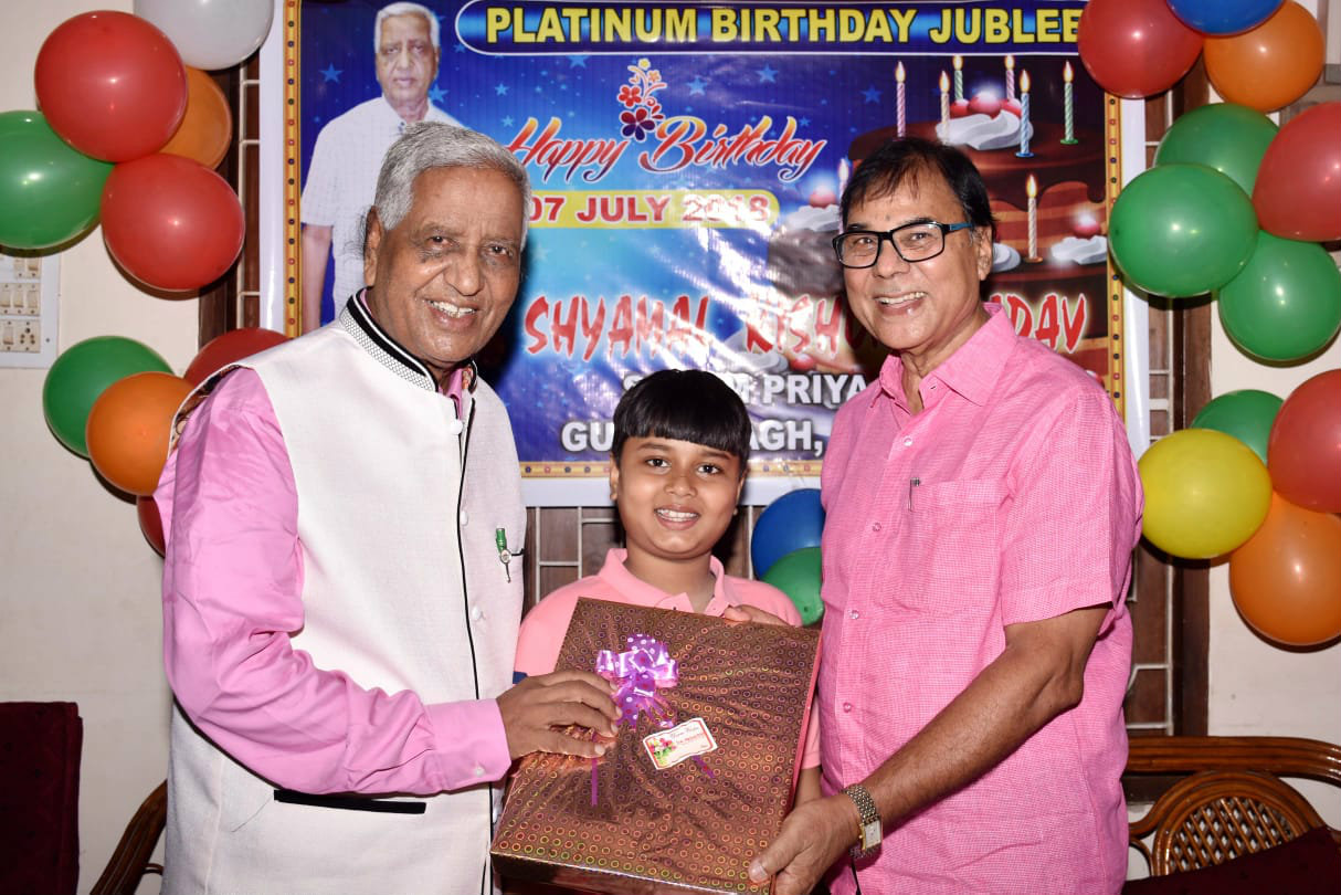 Dr.Madhepuri and his Grandson Aditya wishing Prof.Shyamal kishor Yadav on his 75th Birthday.