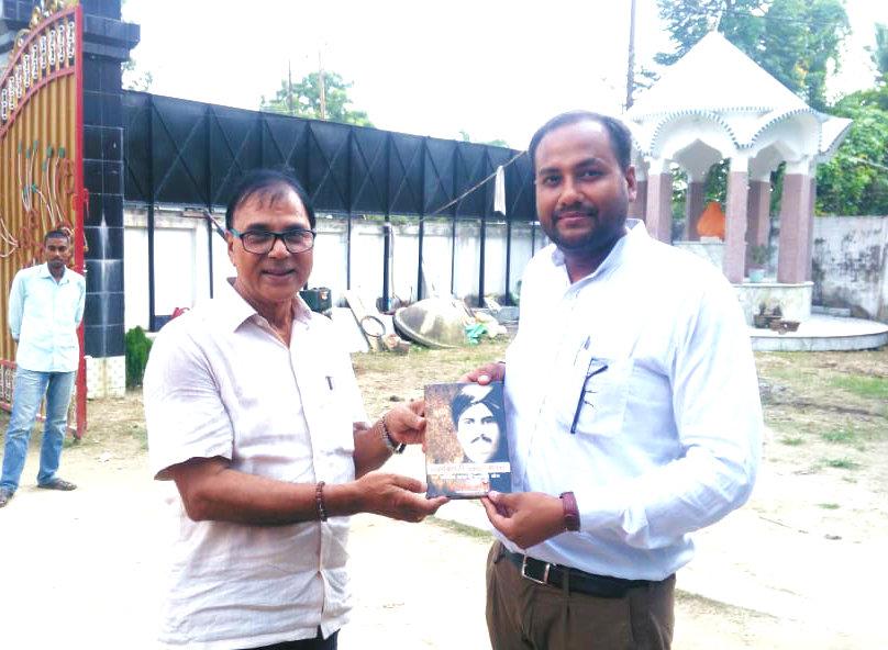 Sahityakar Dr.Madhepuri presenting his new Book
