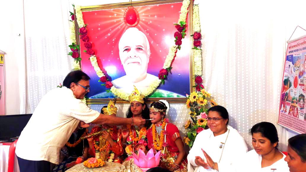 Now Feeding 'Makhan' to Shri Radha Jee.
