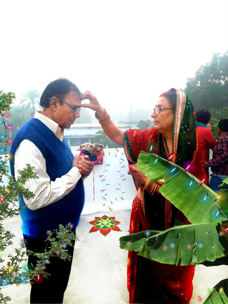 Dr.Madhepuri receiving blessings from Renu Choudhary on behalf of Chhath Maiya.
