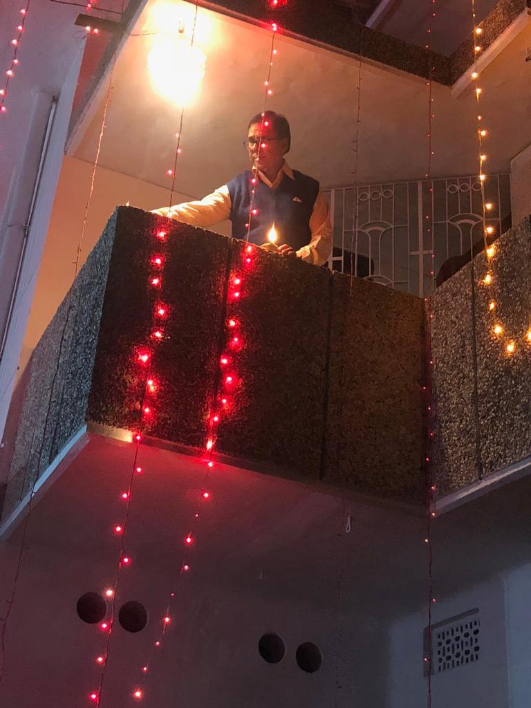 Dr.Madhepuri enjoying Diwali Decoration from the Balcony of