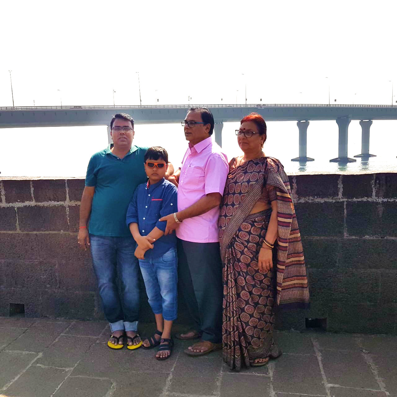Mr. & Mrs.Madhepuri along with their grandson Aditya & his father Dr.Barun standing near Sea-Soar where a Big & Beautiful Road Bridge one can see joining North & South Mumbai.