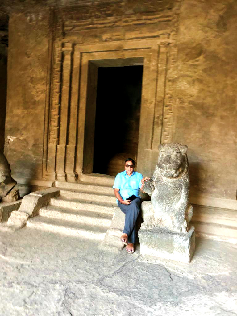 Dr.Madhepuri sitting inside Elephanta Caves in a poetic mood.