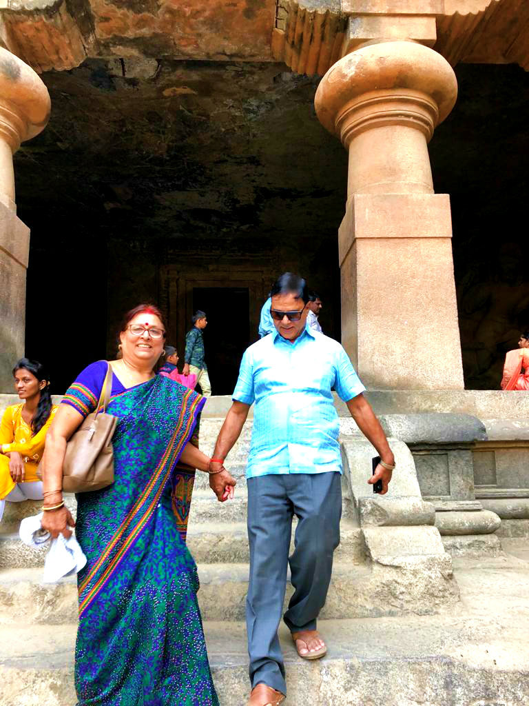 Mr. & Mrs. Madhepuri coming out from Elephanta Caves and landing very cautiously tying their two hands tightly together.....