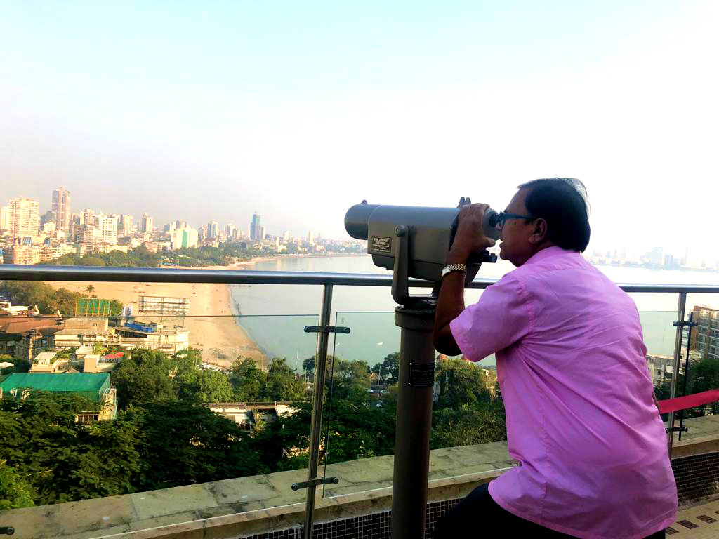 Dr.Madhepuri enjoying the Sea-Soar scenic beauty with a powerful telescope from the top of building.