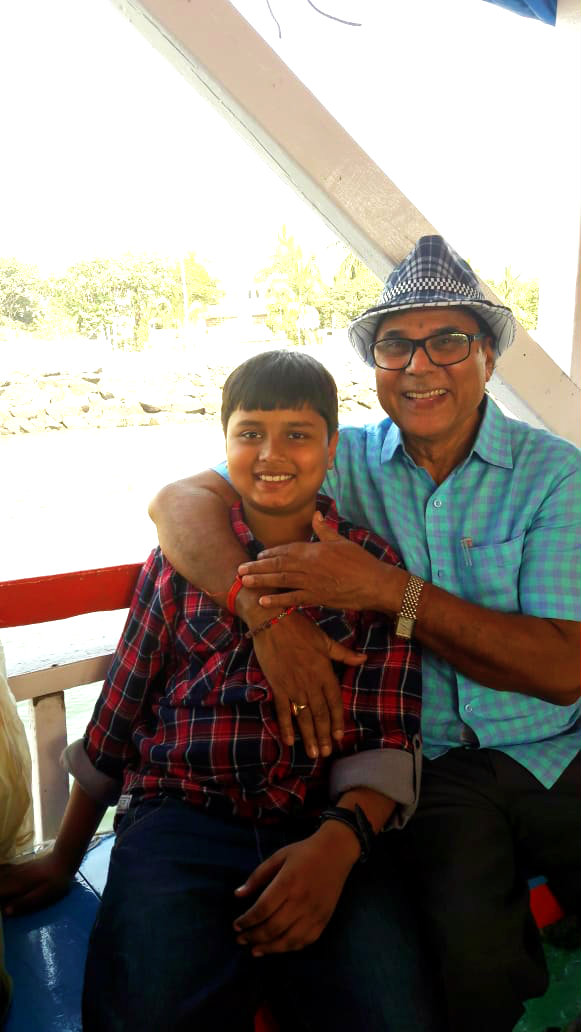 Dr.Madhepuri along with his grandson Aditya enjoying on sea-boat near Mumbai Sea port.