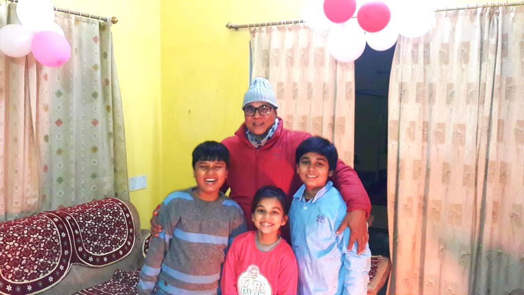 Dr.Madhepuri celebrating New Year along with his grandsons Akaskhya & Aditya & grand daughter Aadya Deep.