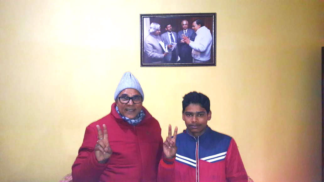 Dr.Madhepuri with victory sign encouraging research loving student Anand Vijay of S.N.P.M. School Madhepura at Vrindavan (Dr.Madhepuri's Residence).