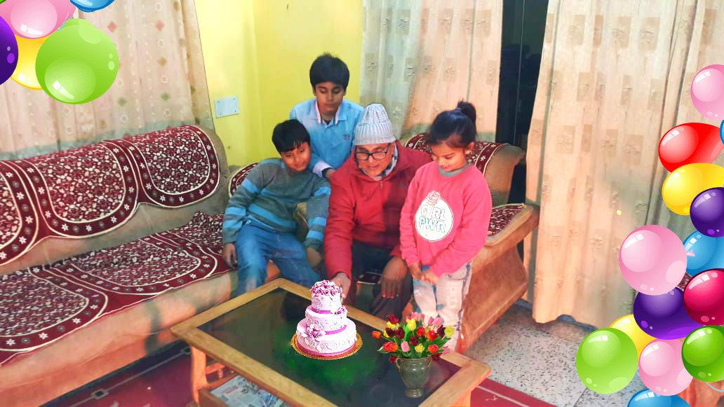 Dr.Madhepuri in the evening of 1st Day of 2019, seen amidst cake & kids at Vrindavan , Madhepura.