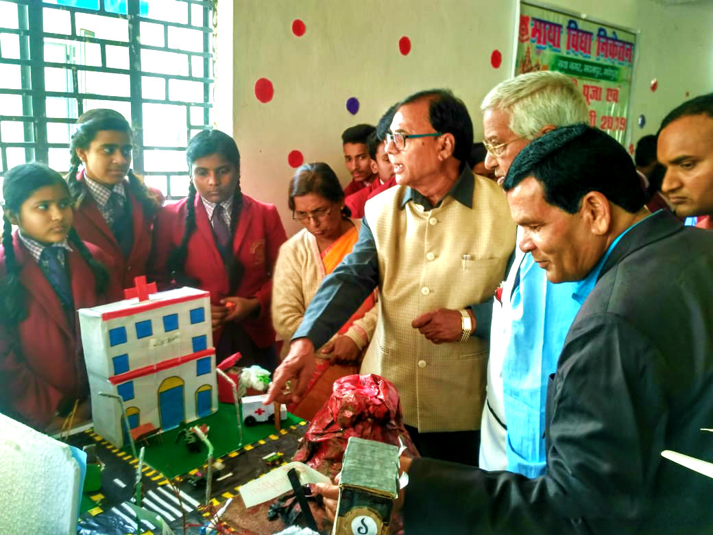 Dr.Madhepuri(Physics), Dr.Naresh Kumar (Chemistry) along with others observing & enjoying the ideas of the curious girls students during Science Exhibition.