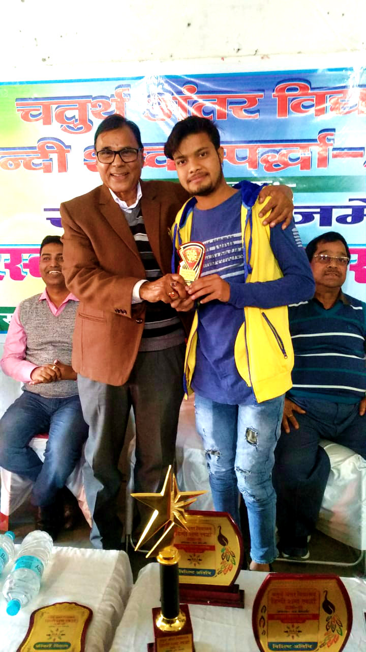 Dr.Madhepuri giving momento to an obedient social activist Md.Atif.