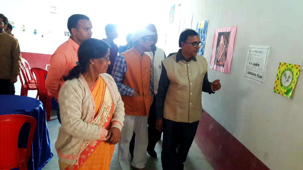 Dr.Madhepuri along with the director Dr.Chandrika Yadav & others observing the Exhibition of Art Gallery.