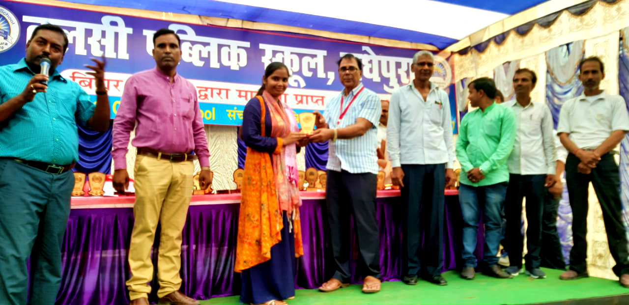 Dr.Madhepuri giving honour to a teacher for the better performance.