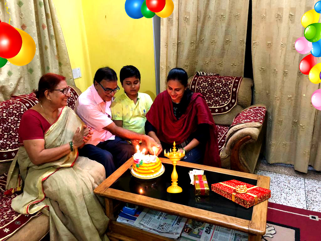 Mr. & Mrs.Madhepuri along with Grandson Aditya celebrating Happy Birthday of Daughter Dr.Rashmi Bharti at Vrindavan, Madhepura.