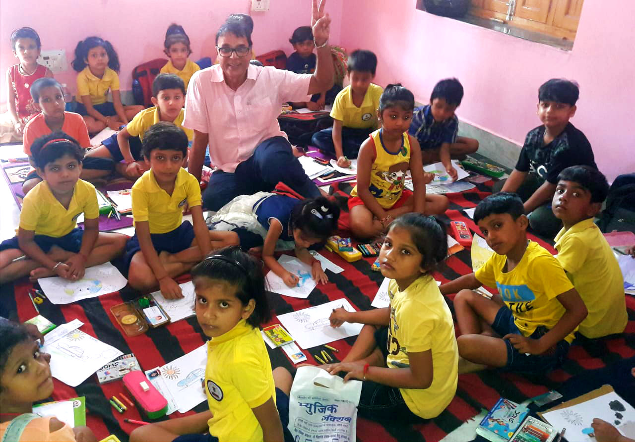 Dr.Madhepuri amidst the little kids engaged in Painting Competition.