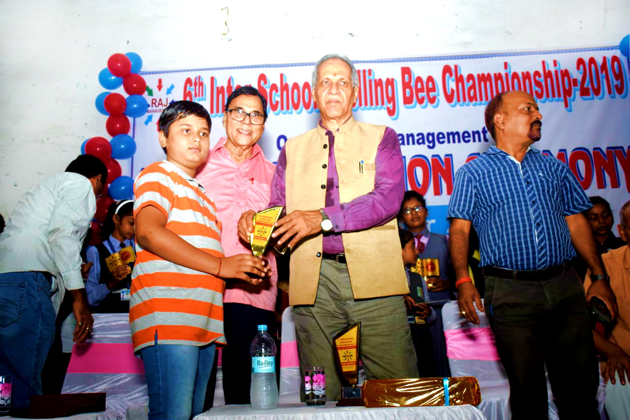Honourable Vice-Chancellor Dr.A.K.Ray giving momento to a participant Aditya in presence of Dr.Madhepuri & SDM Vrindalal.