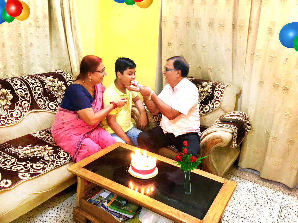 Dr.Madhepuri along with his wife & grandson Aditya celebrating his Son's Happy Birthday at Vrindavan.