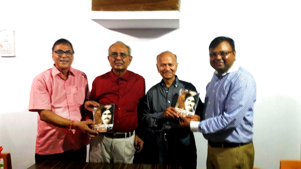 Dr.Madhepuri along with Dr.Arun Kumar Mandal, his brother Sudhir Kumar Mandal (America) & his son Ashish Mandal with Book