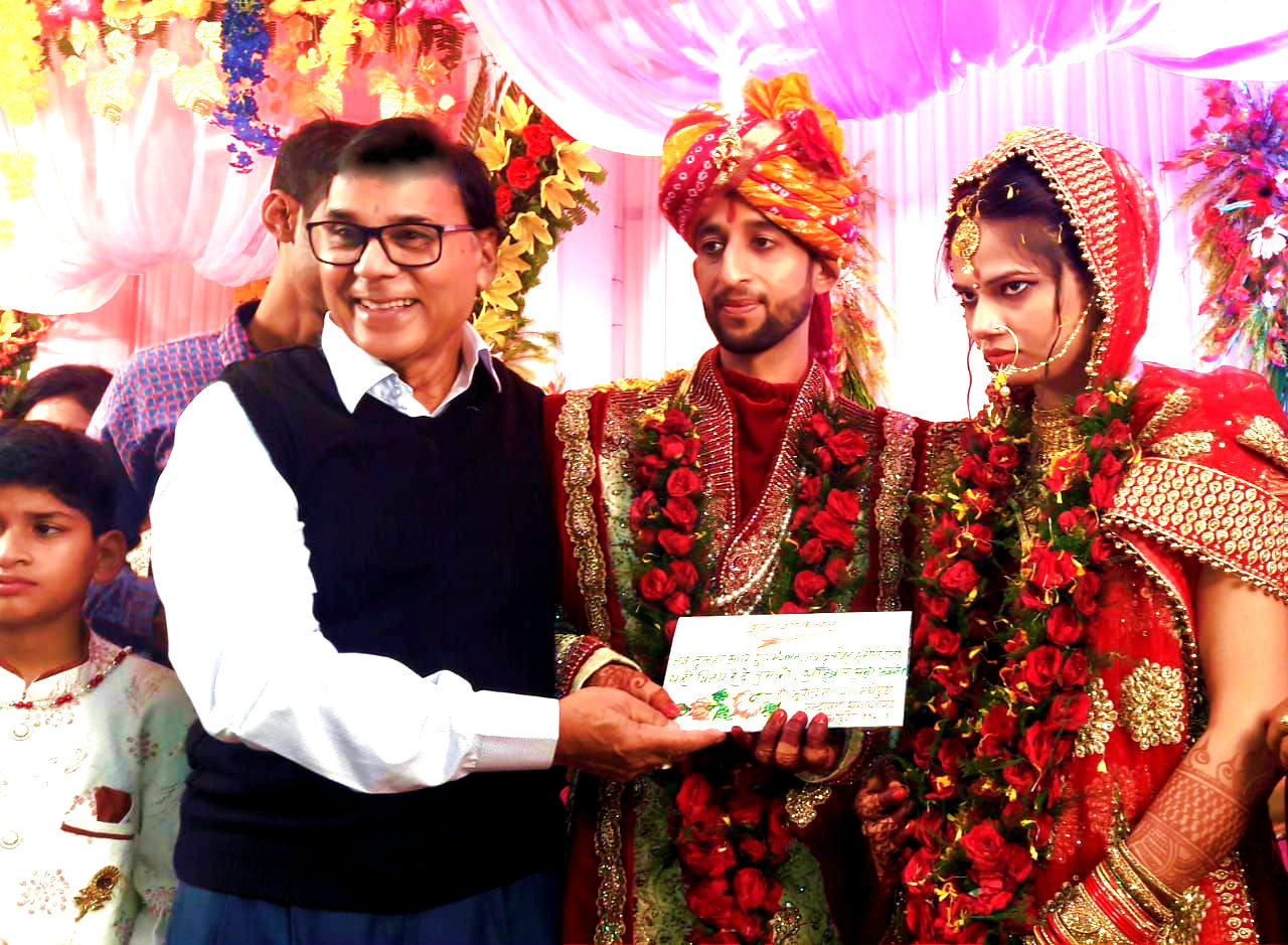 Dr.Madhepuri giving blessings to a newly married couple Arya Guru Manglam & Suniti at Madhepura.