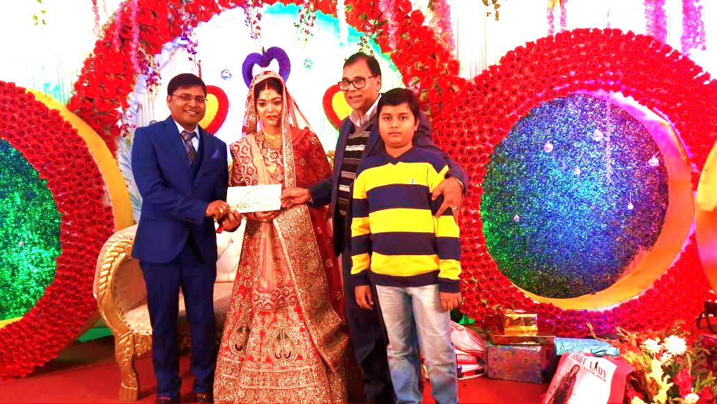Dr.Madhepuri with his grandson Aditya pouring blessings to the newly wed couple Dr.Gaurav & Dr.Khushbu at Madhepura.