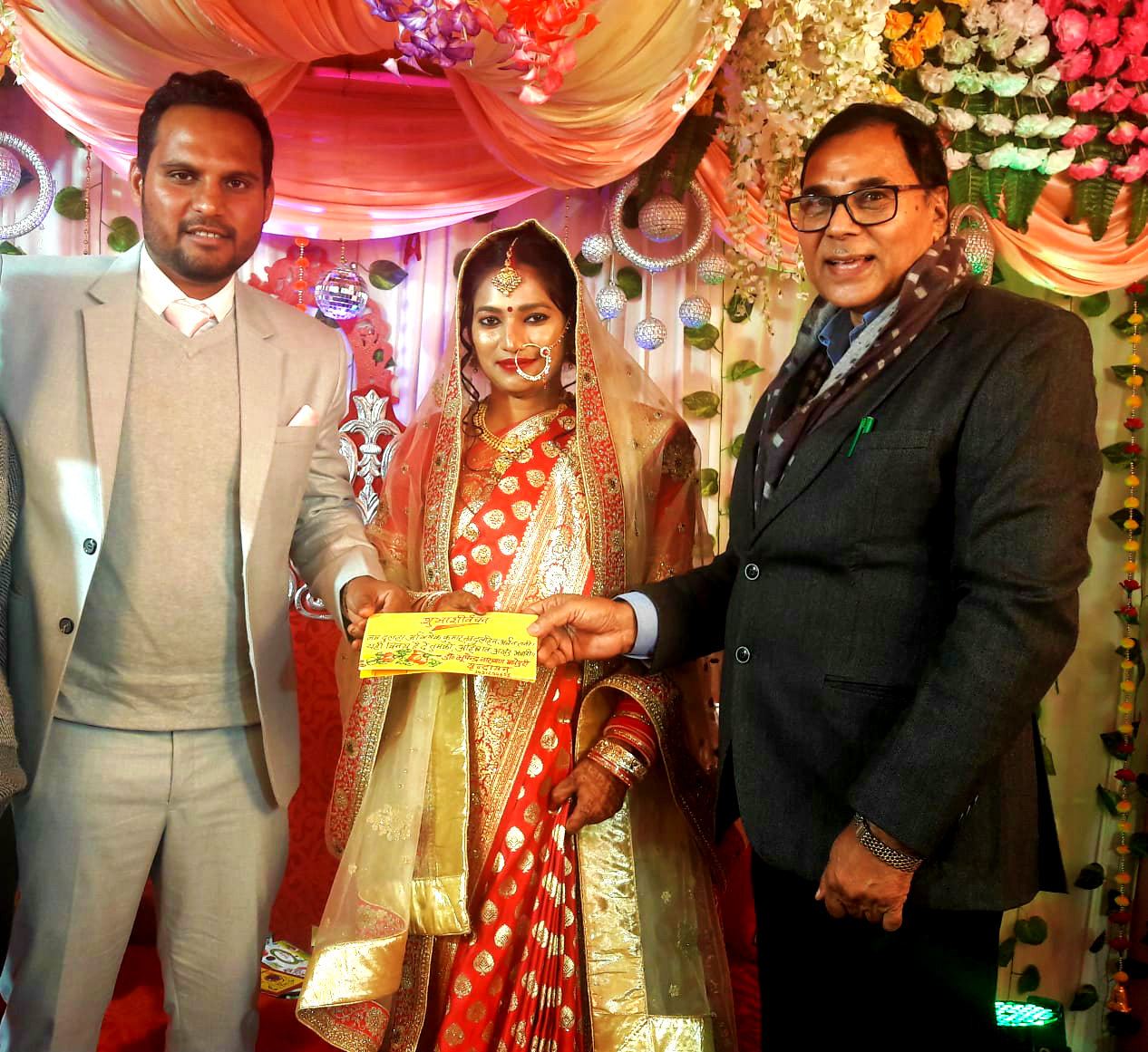 Dr.Madhepuri giving blessings to a newly wed couple Abhishek & Archana.