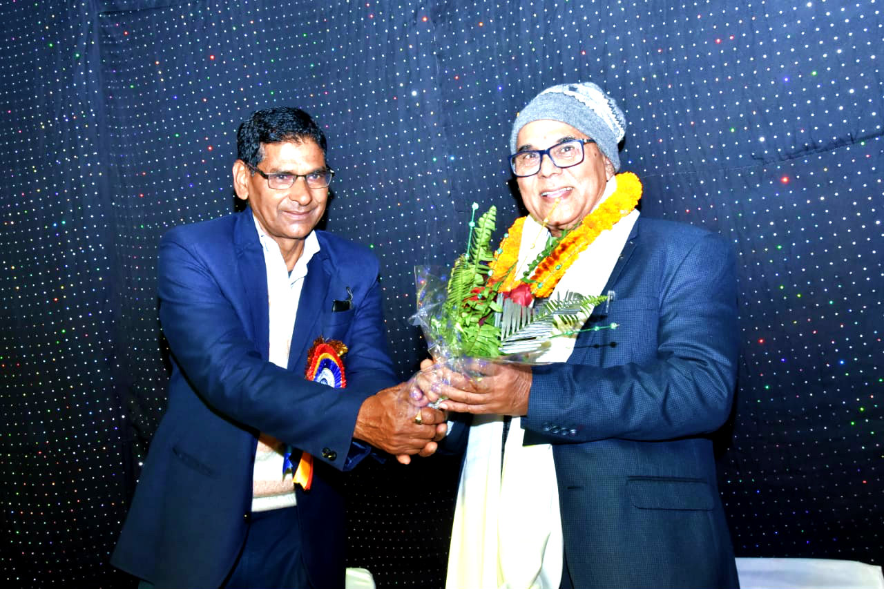 Dr.Madhepuri is being honoured by Principal.