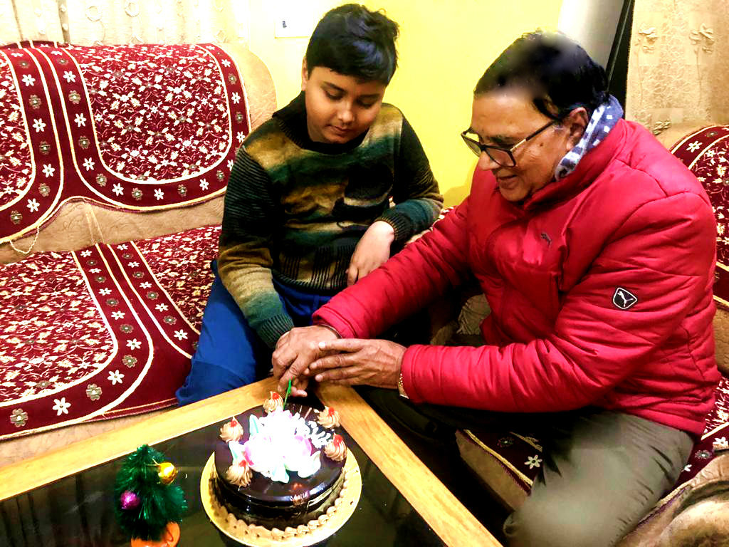 Dr.Madhepuri celebrating Merry Christmas with his grandson Aditya at Vrindavan, Madhepura.