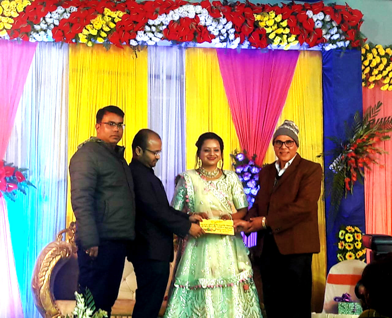 Dr.B.N.Yadav Madhepuri & Dr.Barun Kumar pouring blessings to the newly married couple  Er.Shaket & Er.Girish at the campus of Holly Cross School, Madhepura.