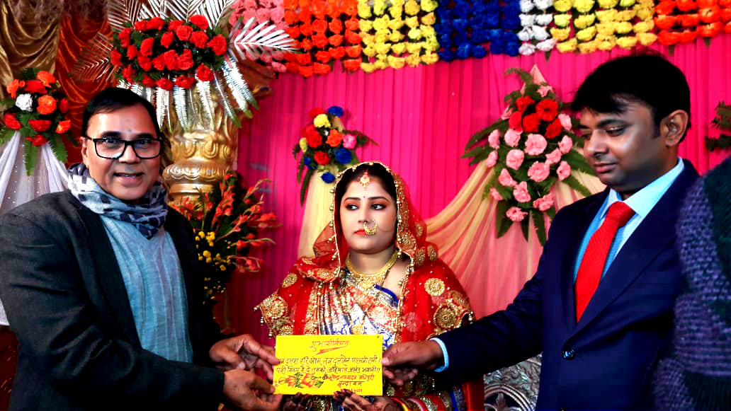 Dr.Madhepuri pouring blessings to the newly wed couple Ayushman Hari Om & Ayushmati Pallavi Renu at Madhepura- 12.