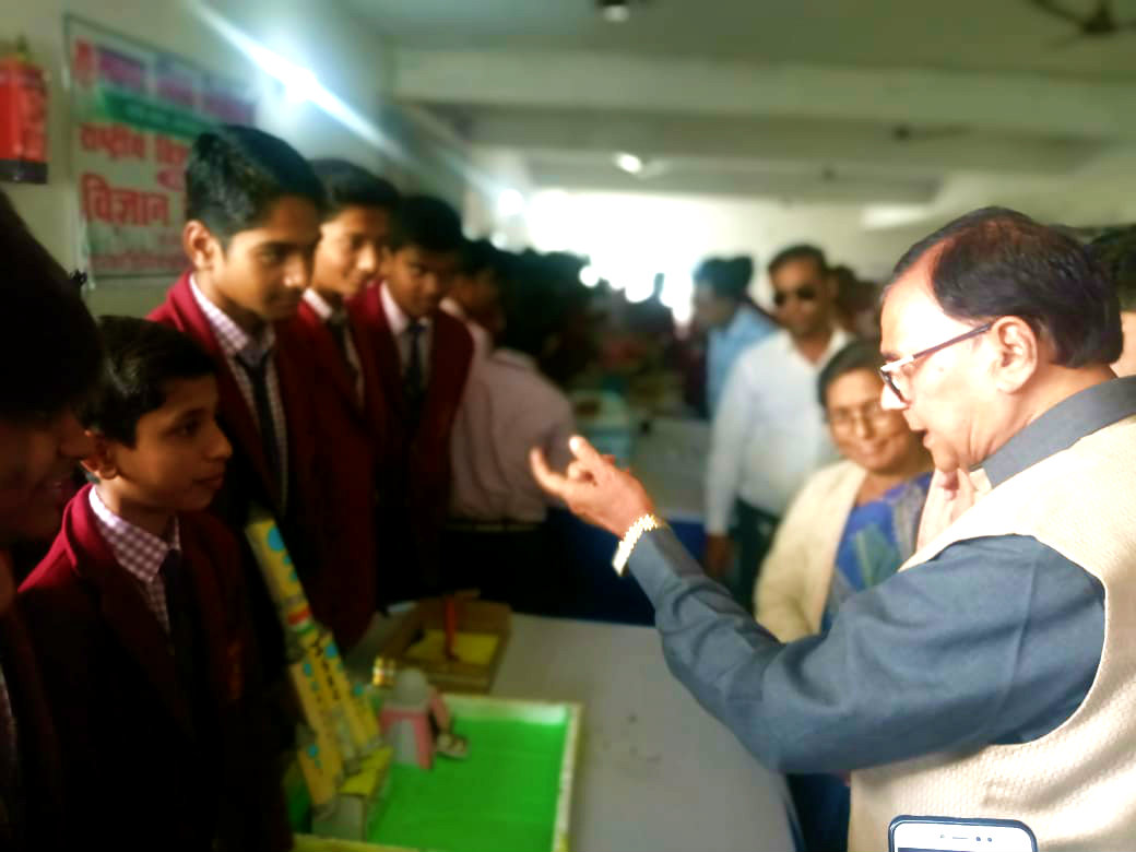 Dr.Madhepuri encouraging the Students along with Principal Chandrika Yadav during Science Exhibition.