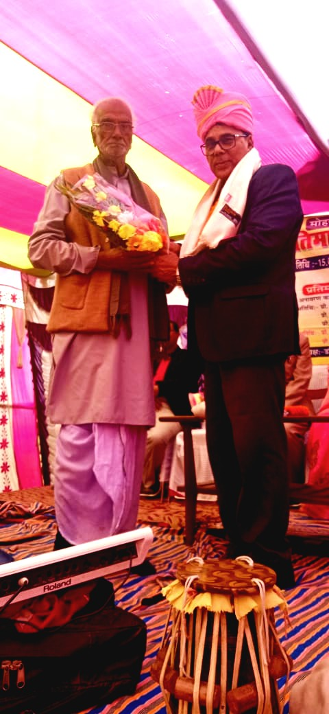 Dr.Madhepuri is being honoured with Paag, Angavastram & Bouquet by the grand & experienced personality.