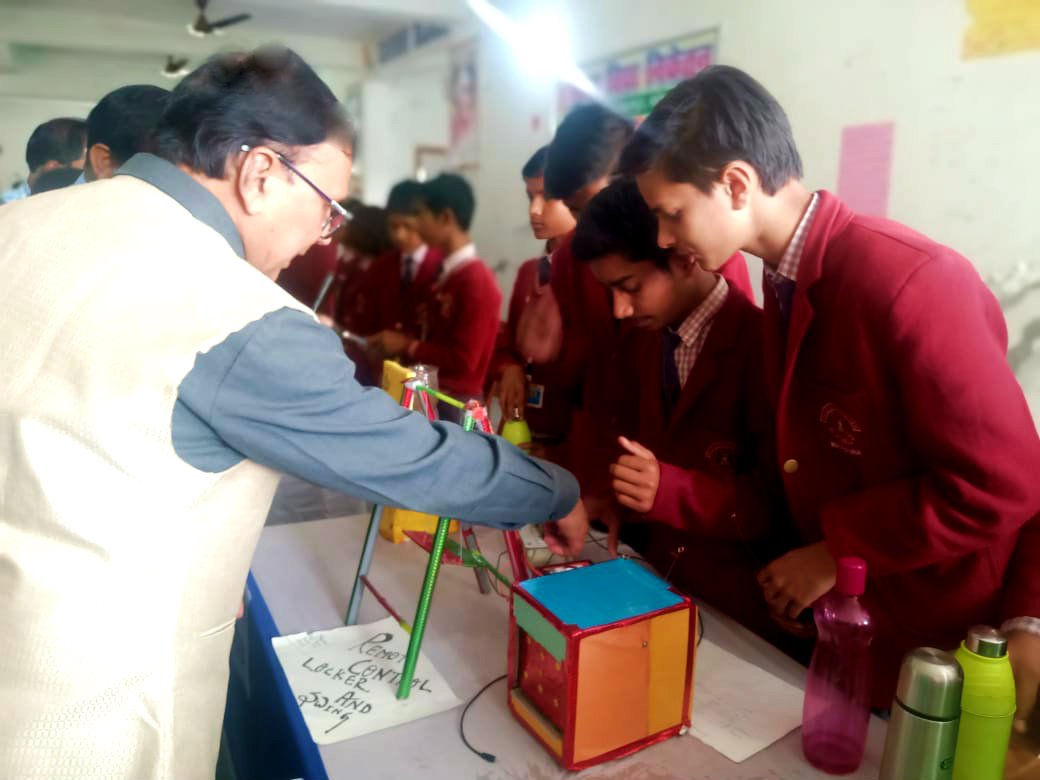 Former University Professor of Physics Dr.Bhupendra Madhepuri watching the Science Projects made by students of Maya Vidya Niketan, Madhepura.