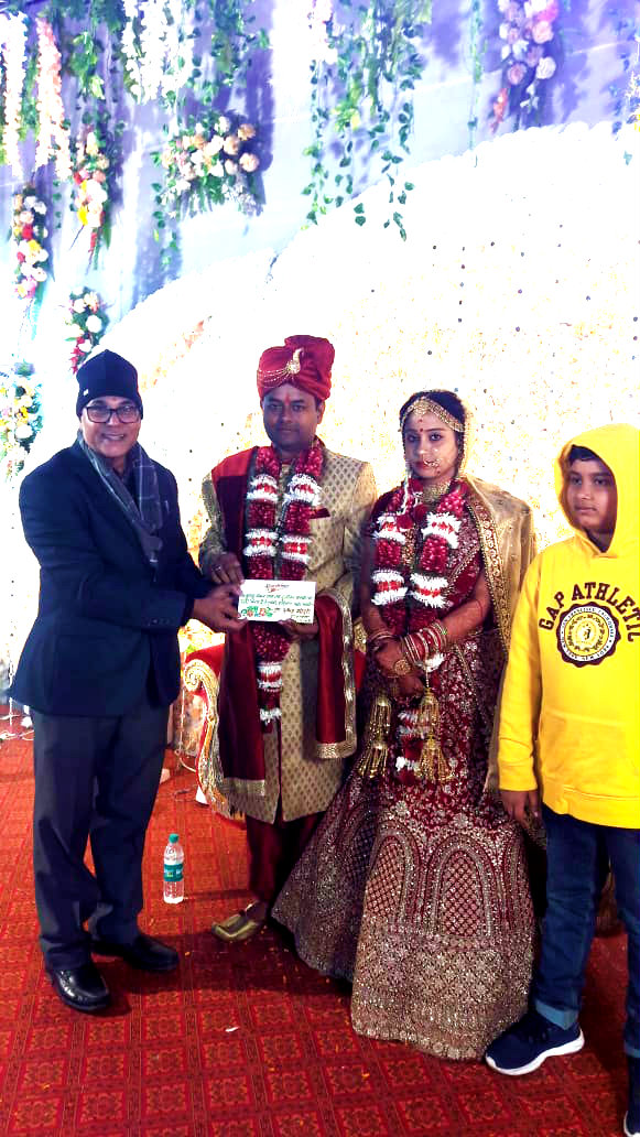 Dr.Madhepuri along with his grandson Aditya pouring blessings to the newly wed couple.