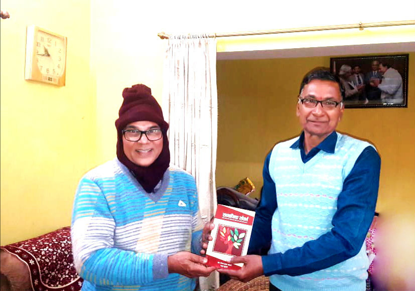 Former Controller of Examination & Registrar of B.N.Mandal University Prof.(Dr.)B.N.Yadav Madhepuri receiving a Book