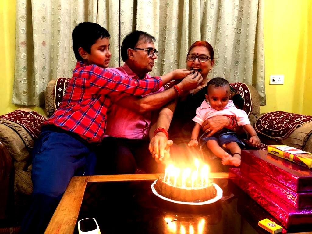 Aditya along with Nana Dr.Madhepuri offering cake bite to Nani on this grand day.