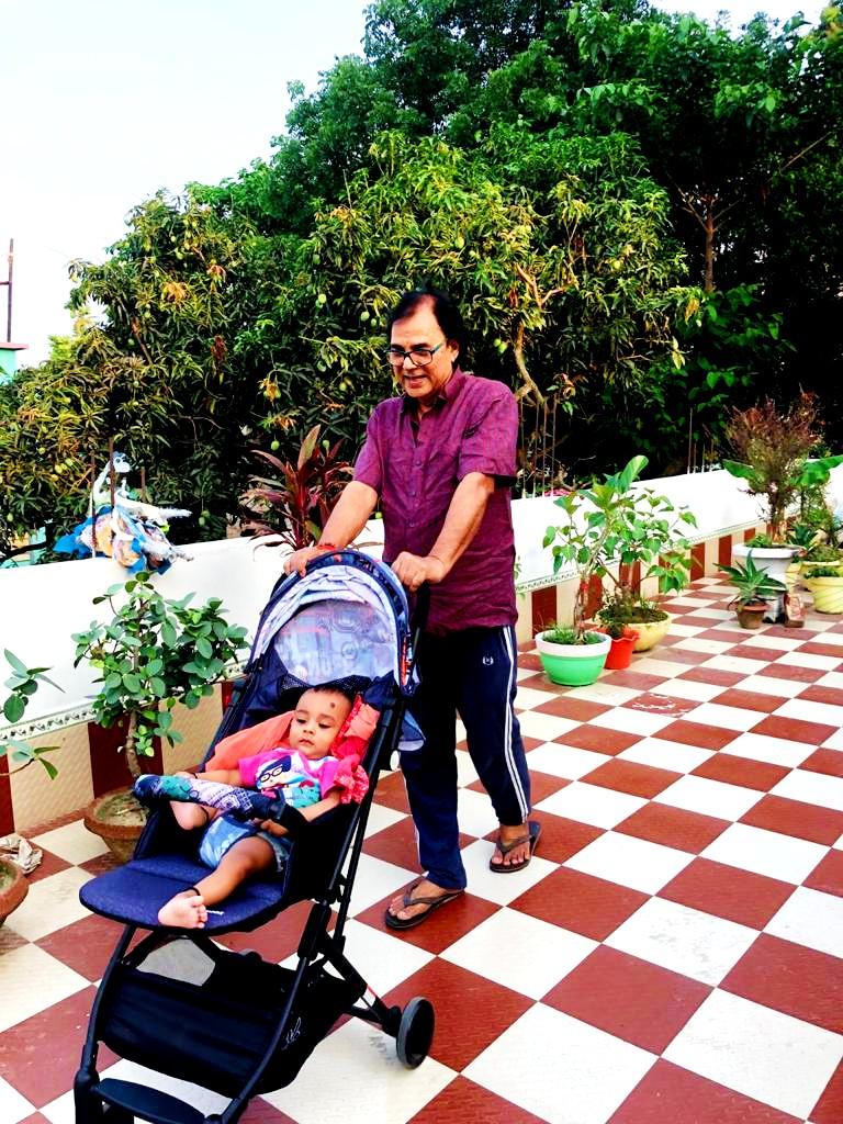 Dr.Madhepuri walking with grandson Chhote Kalam.