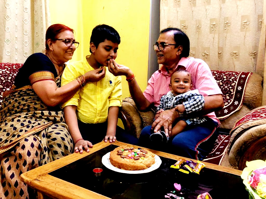 Dr.Madhepuri with wife pouring blessings to Aditya with pieces of Birthday Cake.