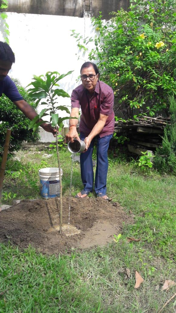 Watering sapling on Earth Day at residence Vrindavan, Madhepura.